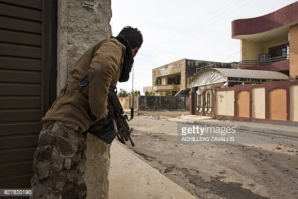 A soldier from the Mosul Brigade of the Iraqi Special Operations Force 2 tries to spot enemy positions during a military operation to retake parts of...