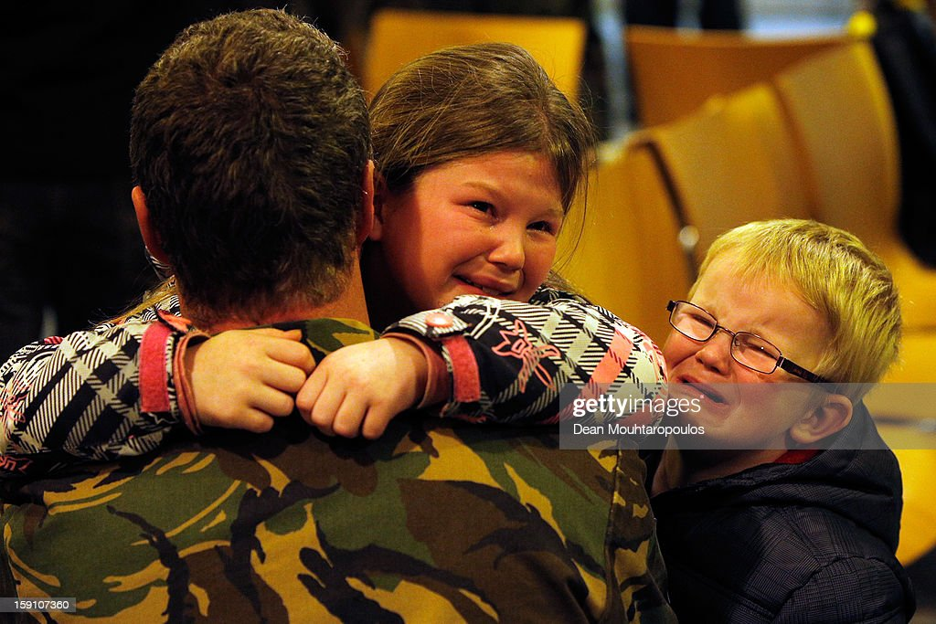 A soldier from the Netherlands embraces his crying children prior to him being transfered to Turkey from Eindhoven Military Airport on January 8, 2013 in Eindhoven, Netherlands. This advance party of Dutch and German troops will fly to Turkey to prepare for the arrival of the Patriots with the main body of European soldiers arriving later in the month.
