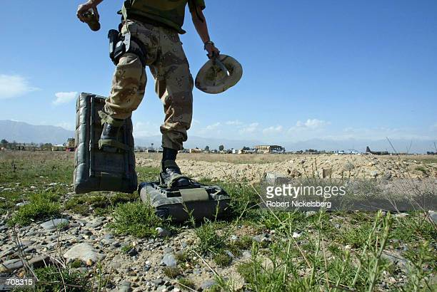 Soldier from the Norwegian de-mining team use air cushion shoes as they search for mines and unexploded ordnance near the airstrip at Bagram Air Base...