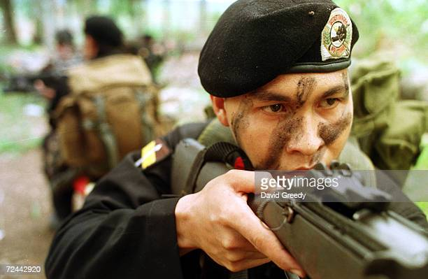 A soldier from the Philippines'' elite Scout Rangers takes aim during training February 20 2002 at the Scout Rangers camp in Isabela on the southern...