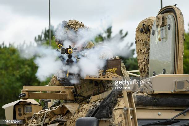 A soldier from the Royal Anglian Regiment returns fire to an attacking force from the mounted gun on a Foxhound armoured vehicle during a military...