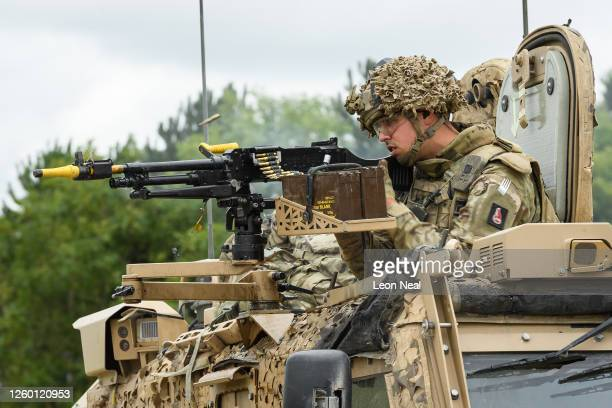 Soldier from the Royal Anglian Regiment returns fire to an attacking force from the mounted gun on a Foxhound armoured vehicle during a military...