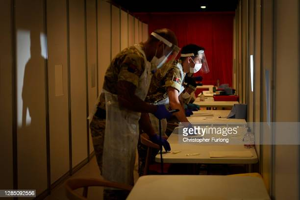 Soldier from the Royal Artillery poses as he and colleagues operate a coronavirus disease testing centre at Liverpool Football Club's Anfield stadium...