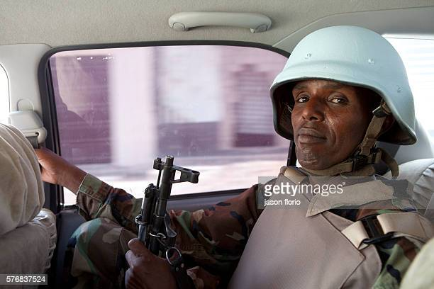 A soldier from the Somali Transitional Federal Government forces wearing body armor while driving through Mogadishu