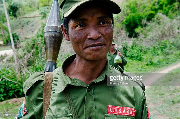 A soldier from the United Wa State Army 171 Division walks through a village in the socalled Southern Wa State The 171 Division is run by the Chinese...
