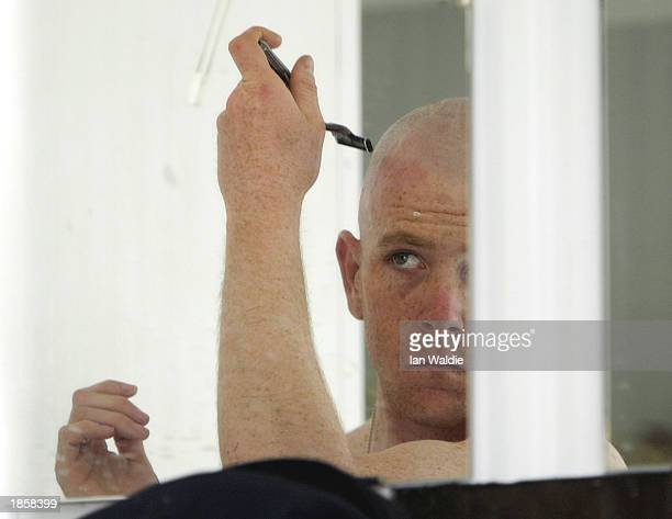 A soldier from the US Army 101st Airbourne Division the 'Screaming Eagles' shaves his head as the regiment traditionally does the day before battle...