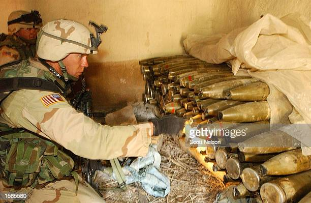 Soldier from the U.S. Army 82nd Airborne Division counts more than a hundred 107mm rockets found November 2, 2002 in the village of Naray in...