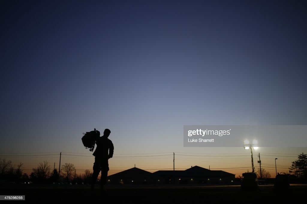 A soldier from the U.S. Army's 3rd Brigade Combat Team, 1st Infantry Division, grabs his rucksack following a homecoming ceremony in the Natcher Physical Fitness Center on Fort Knox on February 27, 2014 in Fort Knox, Kentucky. About 100 soldiers returned to Fort Knox after a nine-month combat deployment conducting village stability operations and working alongside Afghan military and police forces.