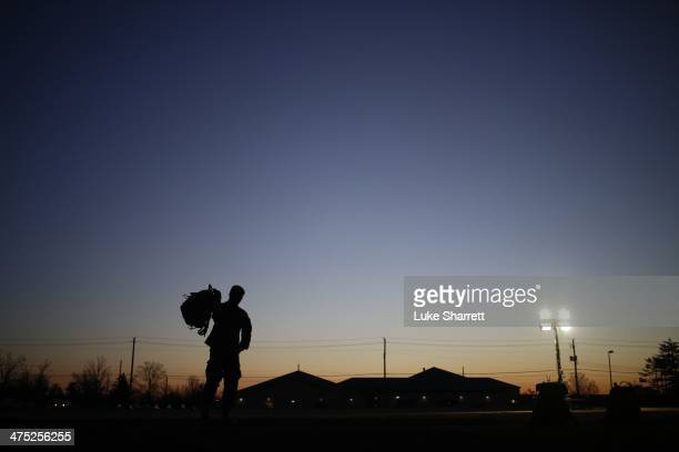 A soldier from the US Army's 3rd Brigade Combat Team 1st Infantry Division grabs his rucksack following a homecoming ceremony in the Natcher Physical...