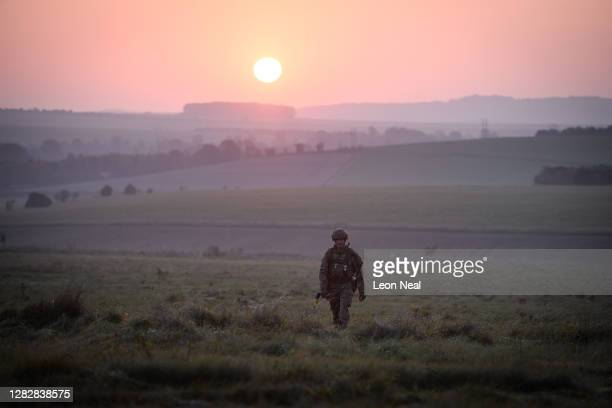 Soldier from the US Task Group patrols the perimeter of the camp just after sunrise during a Mission Rehearsal Exercise ahead of deployment to Mali,...