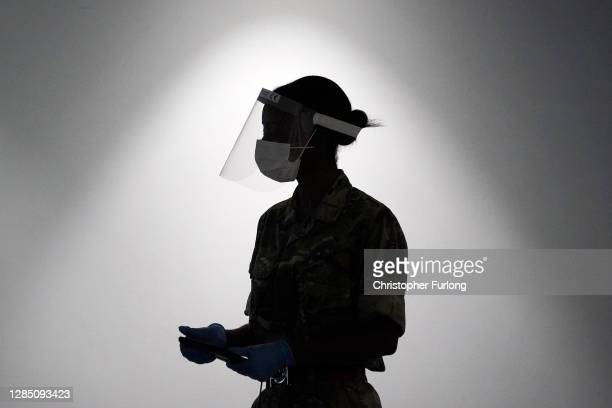 Soldier from the Yorkshire Regiment operates a coronavirus disease testing centre at Liverpool Exhibition Centre on November 11, 2020 in Liverpool,...