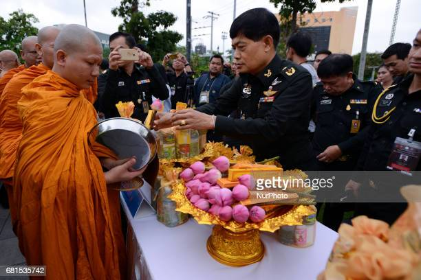 Soldier gather and give alms to monks during a ceremony marking Visakha Bucha Day in Bangkok, Thailand, on 10 May 2017. Visakha Bucha Day on the...