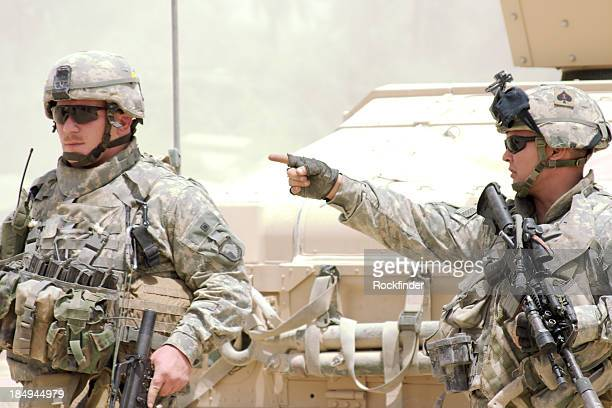 A soldier giving orders to a fellow soldier