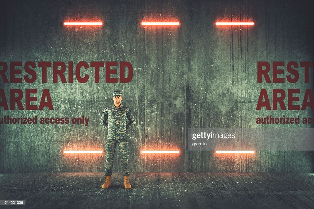 Soldier guarding restricted military area : Stock Photo