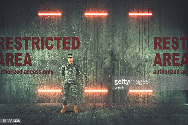 soldier guarding restricted military area - bunker stock pictures, royalty-free photos & images