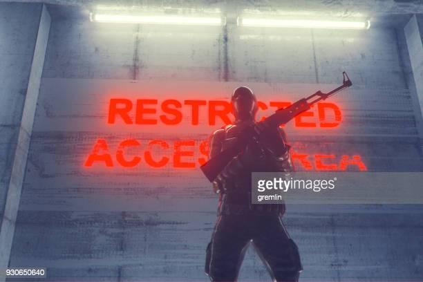 Soldier guarding secret underground facility