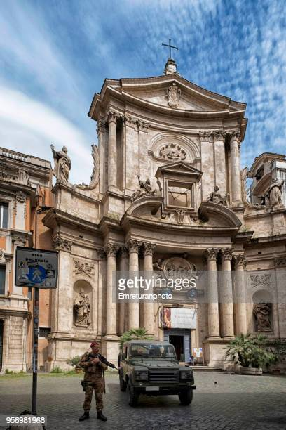 soldier guarding with parked military car in front of a churchin rome. - emreturanphoto stock pictures, royalty-free photos & images