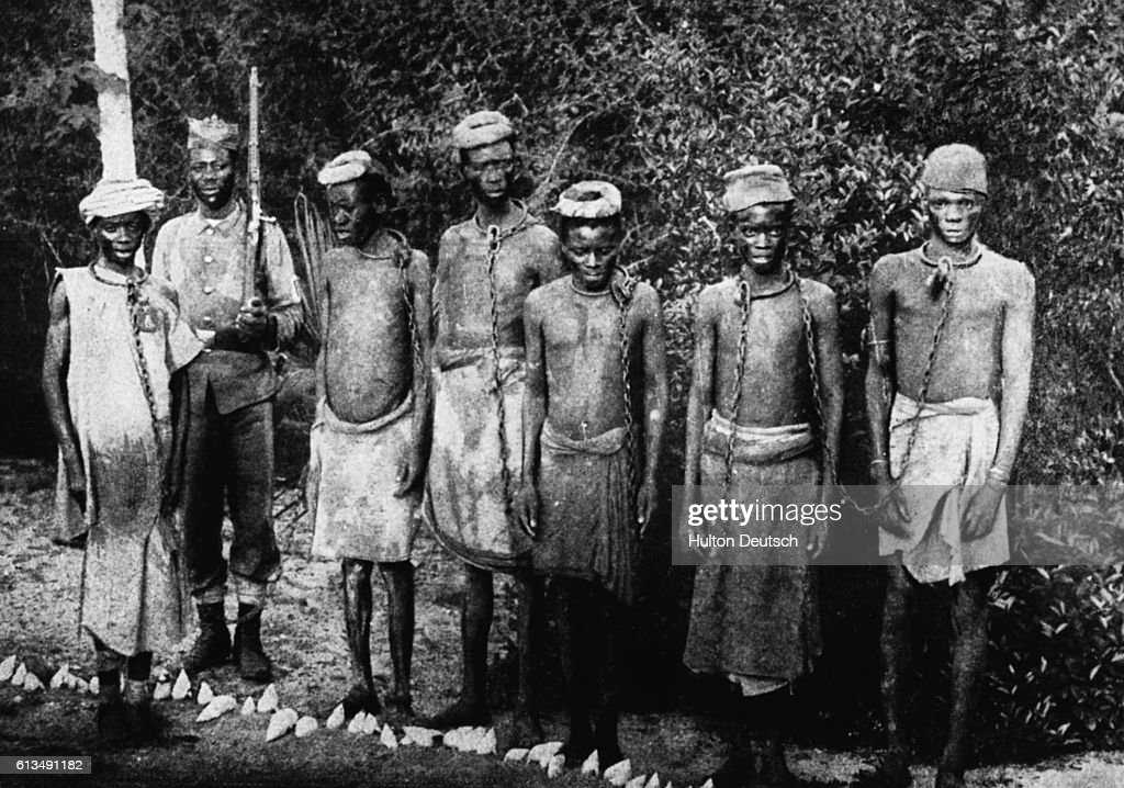 Soldier Guards Slaves : News Photo