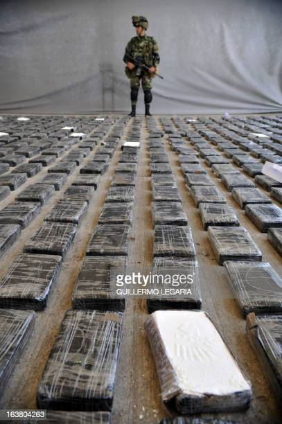 Soldier guards a shipment of 3,9 tons of cocaine seized in a large clandestine laboratory for the production of the drug, during its presentation to...
