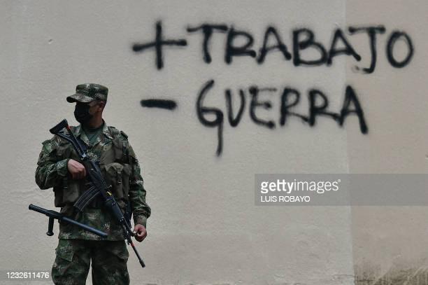 Soldier guards a street in Cali, Colombia, on April 30 a day after a protest against a tax reform bill launched by President Ivan Duque. - A tax...