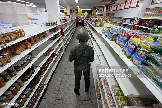A soldier guards inside a supermarket in San Antonio de Tachira Venezuela close to the border with Colombia on August 27 2015 Venezuelan President...