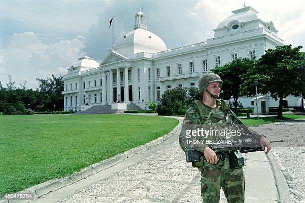 A US soldier guards one of the entrances of Haiti's National Palace in PortauPrince on October 11 1994 shortly after the arrival of a detachment of...