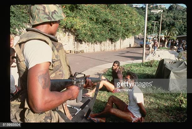 US Soldier Guards Suspected Cuban Fighters in Grenada | Location Grenada