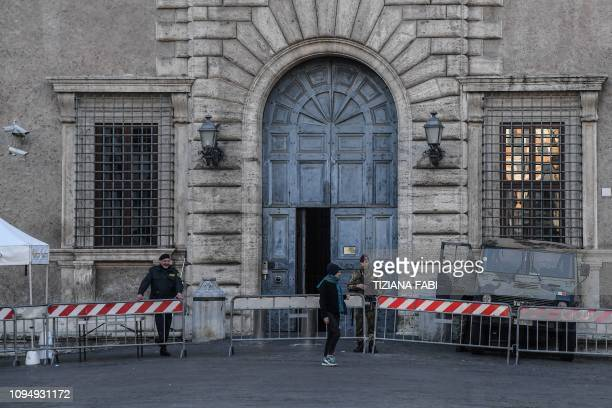 A soldier guards the main entrance of the Palazzo Farnese headquarters of the French Embassy in Rome on February 7 2019 France on February 7 recalled...