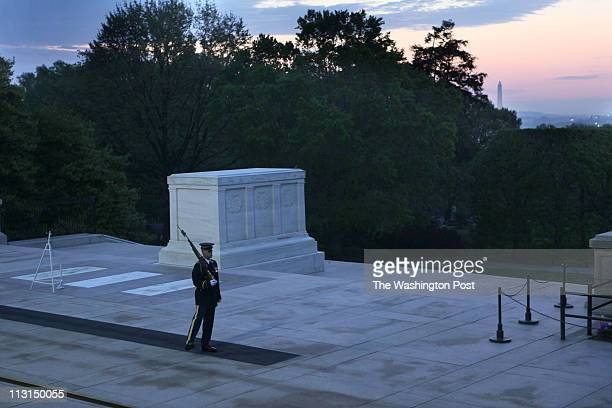 A soldier guards the Tomb of the Unknown Soldier as people arrive for the Easter sunrise service