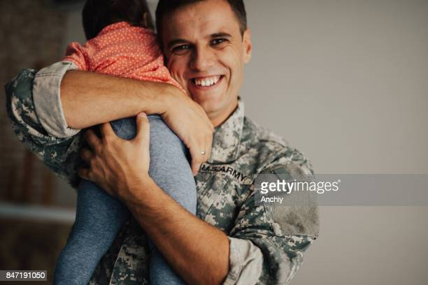 Soldier happy to be finally at home with his baby