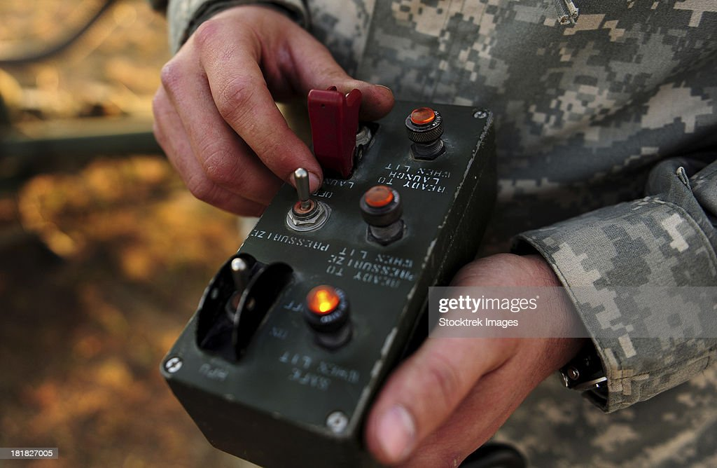 A U.S. soldier hits the button to launch an RQ-7B Shadow. : Stock Photo
