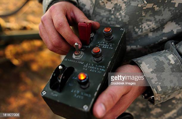 a u.s. soldier hits the button to launch an rq-7b shadow. - detonator stock photos and pictures