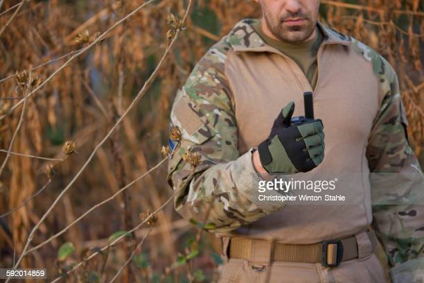 Soldier holding walkie-talkie during training