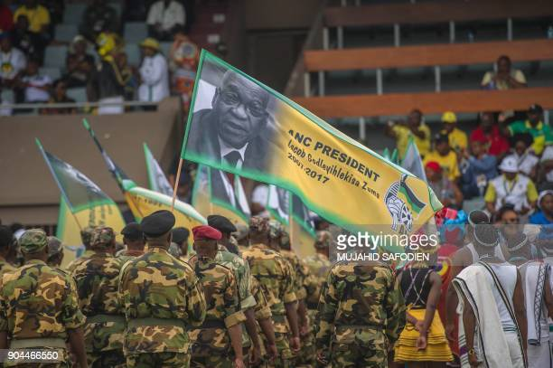 A soldier holds a flag bearing a portrait of South African President and former African National Congress President Jacob Zuma during the ANC's 106th...