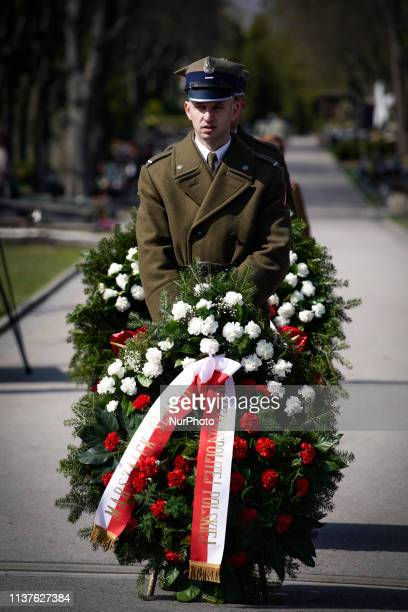 A soldier holds a wreath while awaiting the arrival of PM Mateusz Morawiecki at the Powazki military cemetery in Warsaw Poland on April 10 2019...