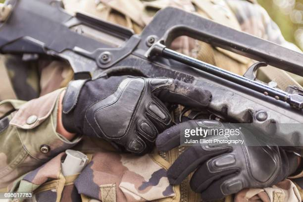 a soldier holds his gun. - machine gun stock pictures, royalty-free photos & images