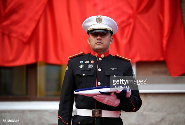 A soldier holds the Panamanian flag during the inauguration of the Panama embassy in Beijing on November 16 2017 Panama opened its first embassy in...