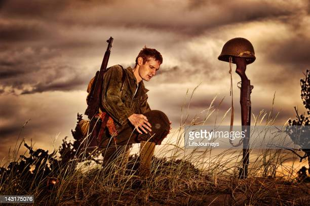 wwii soldier honoring fallen friend - bayonet stock pictures, royalty-free photos & images