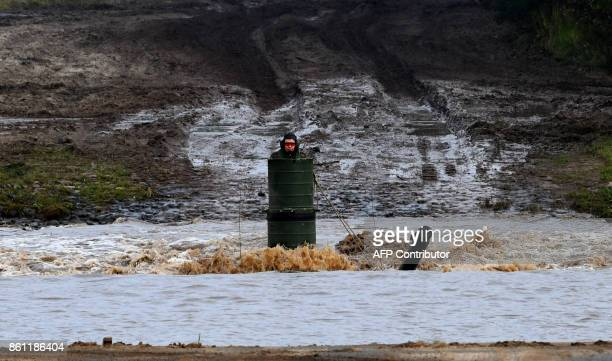 A soldier in a Leopard 2 A7 main battle tank of the German armed forces Bundeswehr drives through the water in the context of an informative...