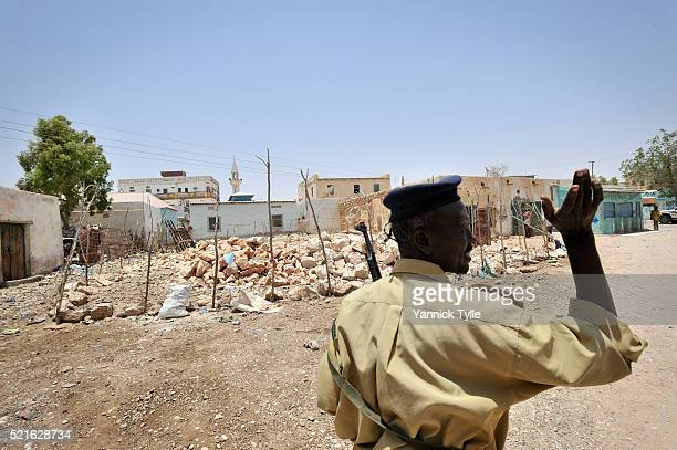 soldier in a street in bosaso - bosaso stock pictures, royalty-free photos & images