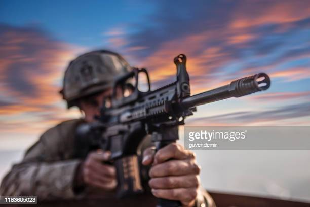 soldier in a trench - army stock pictures, royalty-free photos & images