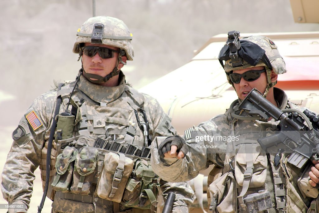 A soldier in a war zone giving orders : Stock Photo