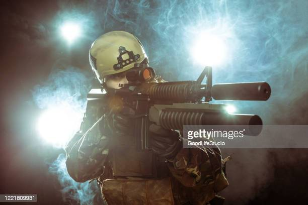 soldier in action - machine gun stock pictures, royalty-free photos & images