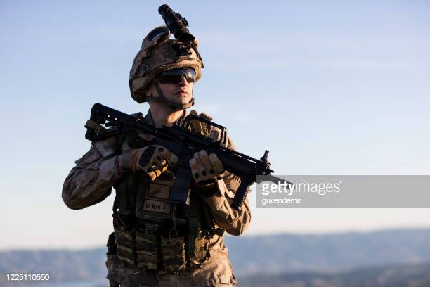 soldier in battlefield - army soldier stock pictures, royalty-free photos & images