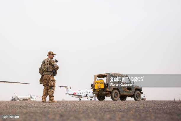 Soldier in front of a plane of the ICRC on April 07, 2017 in Gao, Mali.