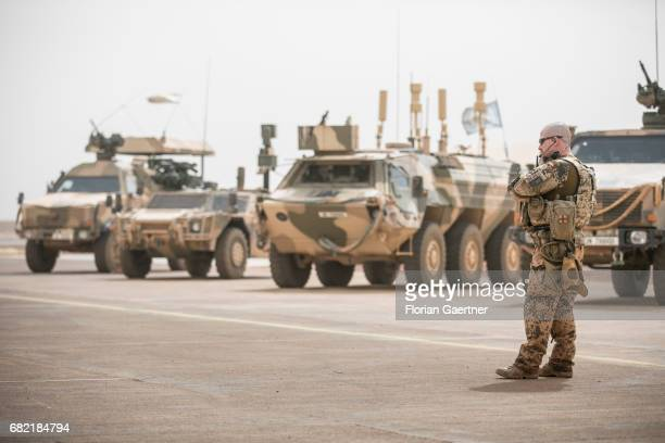 Soldier in front of military vehicles on a United Nations base in Mali on April 07 2017 in Gao Mali