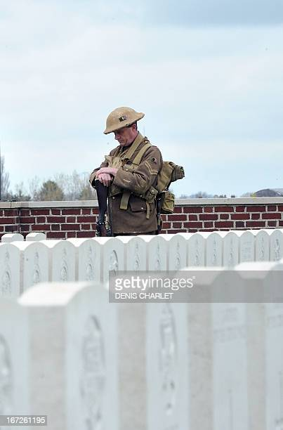 A soldier in period uniform pays homage on April 23 2013 in the Honourable Artillery Company Cemetery at EcoustSaint Mein as four British soldiers...