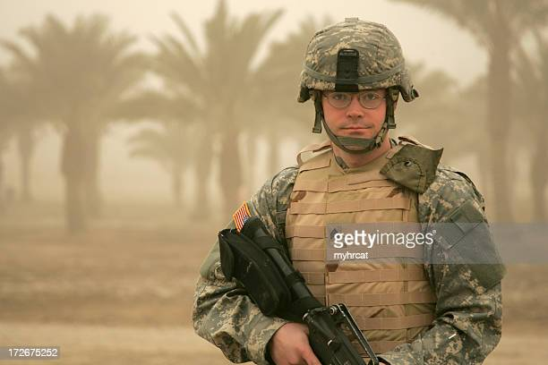 soldier in sandstorm with body armor - iraq war stock pictures, royalty-free photos & images