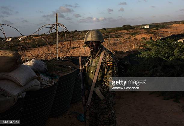 Soldier in the 17th Battle Group of the Uganda People's Defense Force serving in the African Union Mission in Somalia stands at his post inside...