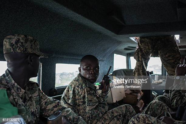 A soldier in the 17th Battle Group of the Uganda People's Defense Force serving in the African Union Mission in Somalia talks on his radio in a...